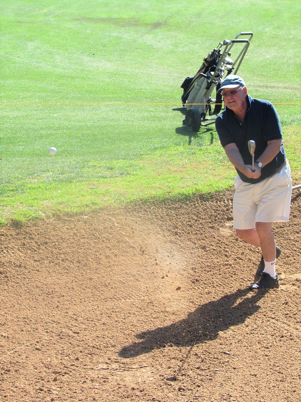 Playing out of a bunker at the Royal Club